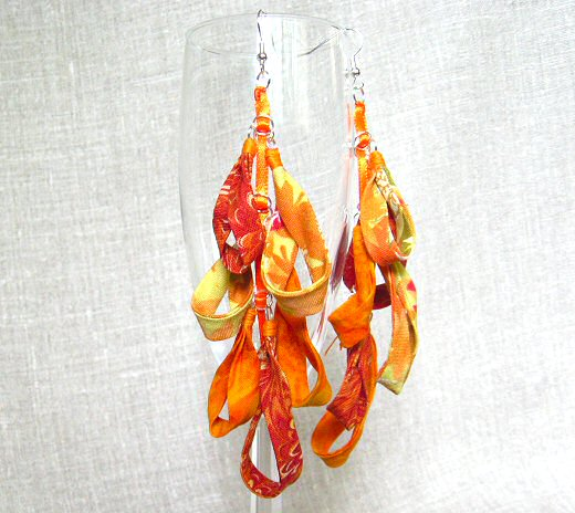 fabric chandelier earrings in orange
