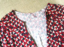 top with tie removed from neckline