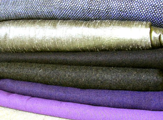 stack of fabrics in different fibers and weaves