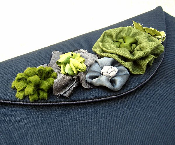 fabric flower embellishments on the idyllic envelope clutch