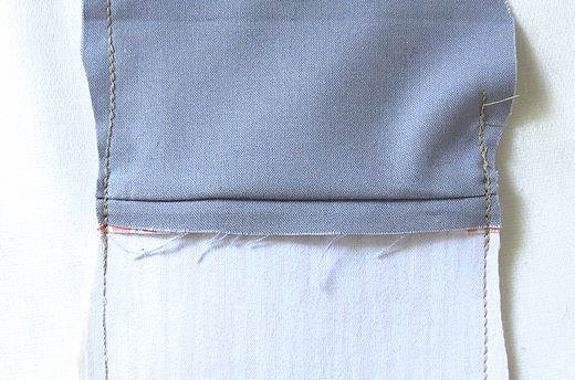 trim close to the stitching at the ends of the zipper