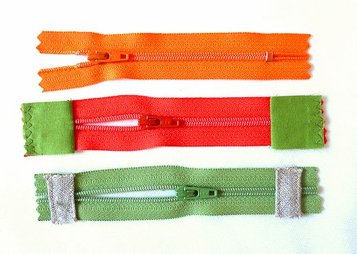 zippers with new fabric tabs attached