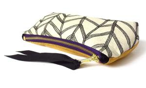 zip pouch with gold leather and hand drawn chevron motif