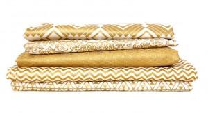 stack of metallic gold fabric