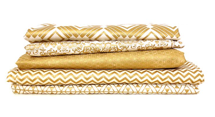 stack of metallic gold fabric