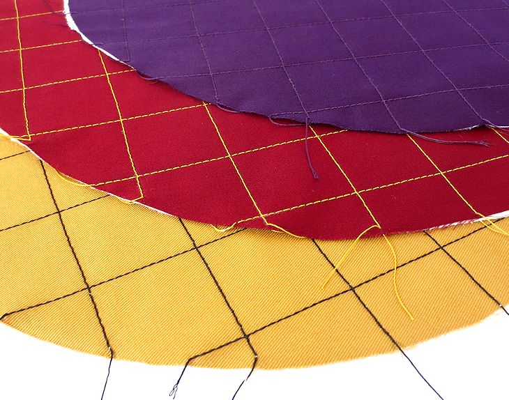topstitching on gold, red, and purple twill ~ button scarves in progress