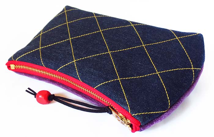 denim pouch with gold topstitching