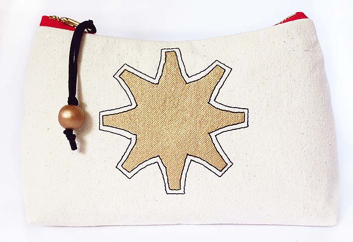 zip pouch with painted star motif