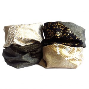 white, black, and gold infinity scarves from Holland Cox