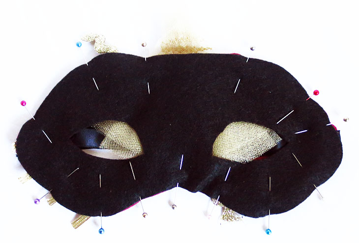 mask with black lining pinned in place