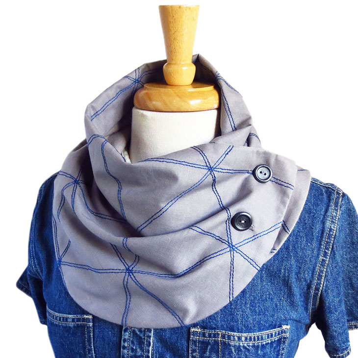 the andromeda button scarf in gray and blue